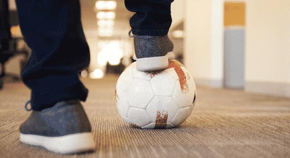 Pavilion employee playing soccer